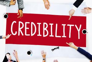 banner that says credibility